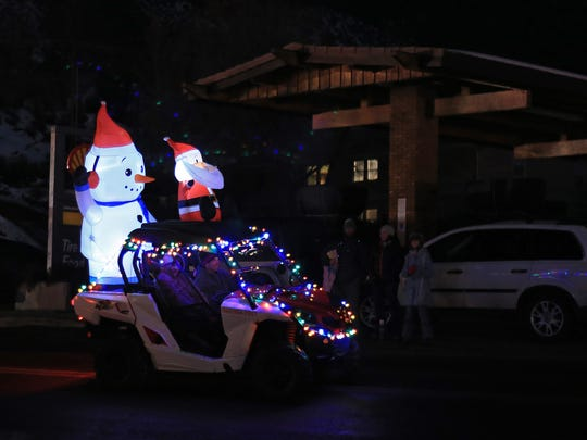An entry in the Zion Joy to the World Light Parade passes through downtown Springdale. This year's parade begins at 7 p.m. Saturday.