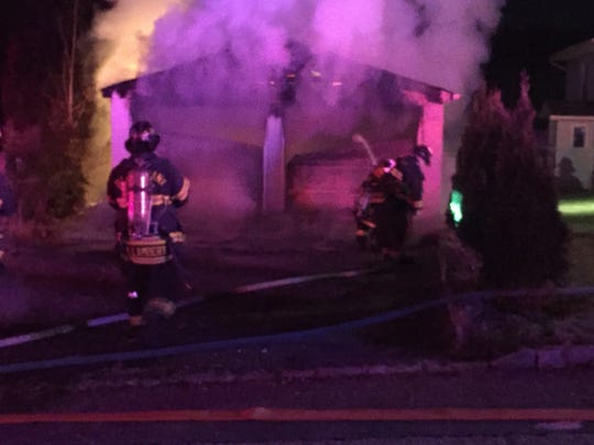 A fire consumed a detached garage, setting off bullets