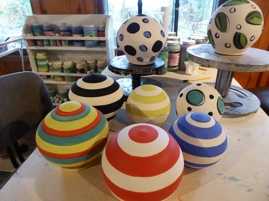 These clay balls created by Mary Lou Zeek, who founded the Salem Art Association's annual Clay Ball fundraiser, will be up for auction at this year's ball on Feb. 27. The clay balls were sent as invitations to the early guests of the ball.