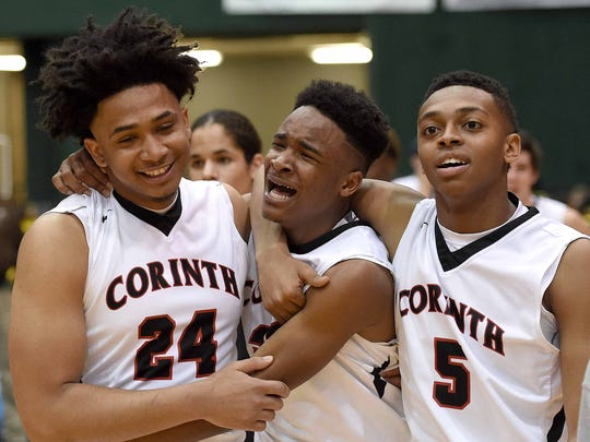 Corinth's Axavius Stricklen (center) is overcome with