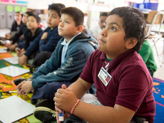 Second-grader Felipe Merales-Torres listens to a lesson