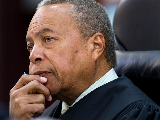 Nashville Criminal Court Judge Monte Watkins listens during a hearing at the Justice A.A. Birch Building, Friday, April 1, 2016, in Nashville, Tenn.
