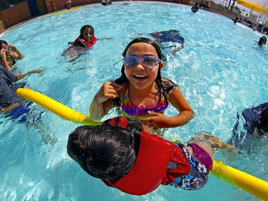 Isabella Creek, 7, plays with friends at Encanto pool in Phoenix on Saturday, May 28, 2016.