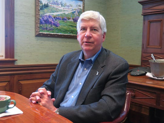 Gov. Rick Snyder speaks during an interview at the
