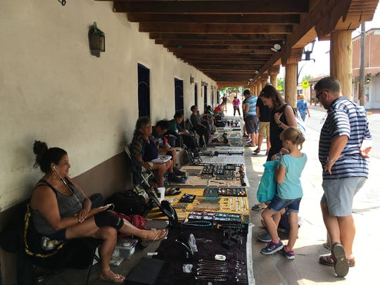 In this Wednesday, June 22, 2016 photo, American Indian jewelers sell their artwork in the plaza of Albuquerque's Old Town, N.M. The nation's Hispanic population grew by 2.2 percent to 56.6 million, and New Mexico had the largest percentage of Latinos in the country at 48 percent, according to new information from the U.S. Census Bureau. Data also showed New Mexico has one of the highest percentages of minorities in the country.