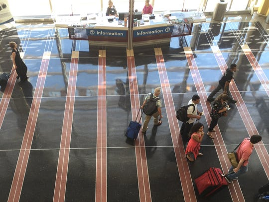 Passengers walk along the main concourse at Reagan National Airport on Sept. 6, 2016. Fifteen years after the Sept. 11 terror attacks, the nation's 450 or so commercial airports remain on steady alert. (Tim Johnson/McClatchy Washington Bureau/TNS)