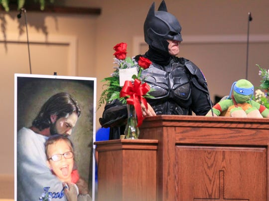 John Buckland, dressed as Batman, speaks during the funeral for Jacob Hall on Wednesday, Oct. 5 at Oakdale Baptist Church in Townville, S.C.