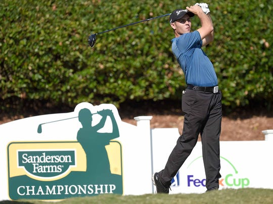 Matt Atkins watches his tee shot on number one on Thursday,