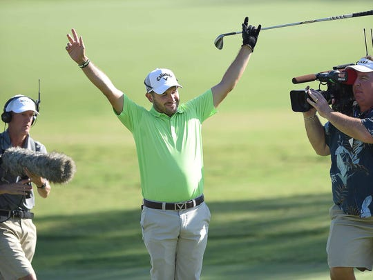 Julian Etulain celebrates after holing his fairway