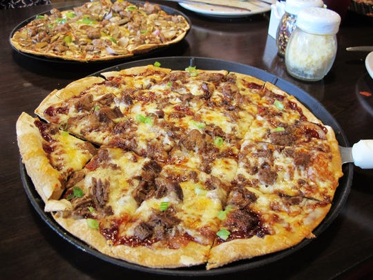 The Stockyards Smoked Brisket thin-crust pizza at Henning's Chicago Kitchen, 2360 Pine Ridge Road, Naples, features chopped beef brisket, cayenne candied bacon, Sweet Baby Ray's barbecue sauce and green onion.
