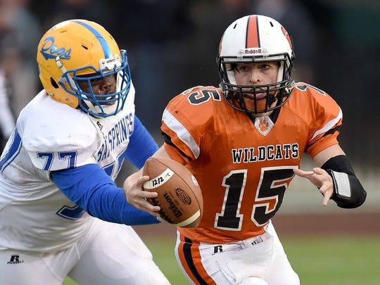 Calhoun City quarterback Joseph Gray (15) tries to