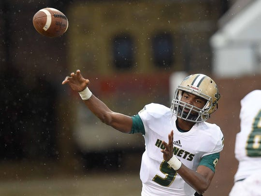Poplarville quarterback Antonio Barnes (9) throws against
