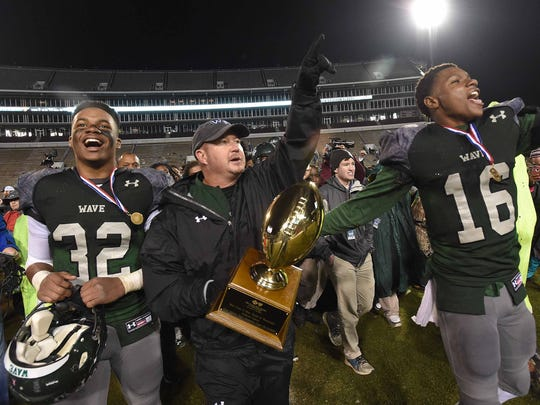 West Point head coach Chris Chambless and the Green Wave celebrate with the Class 6A trophy after beating Laurel 29-8 on Saturday, December 3, 2016, at the MHSAA Football State Championships in Davis Wade Stadium on the Mississippi State University campus in Starkville, Miss.