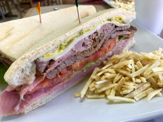 The Azucar special sandwich is made with thin cuts of steak, ham, roasted pork, lettuce, tomato, Swiss cheese, pickles and mustard on Cuban bread.