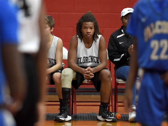 Tavion Grau waits on the bench for an opportunity to play against Velma Jackson on Thursday.