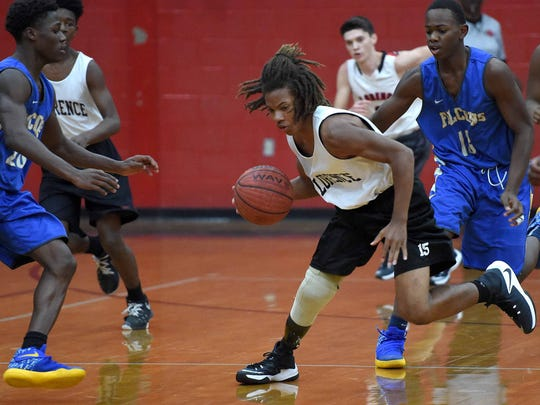 Tavion Grau (15) steals the ball against Velma Jackson on Thursday, December 8, 2016, at Florence High School in Florence, Miss. Tay lost his lower right leg after an ATV accident in May 2015. Eighteen months later he is back playing on the junior varsity basketball team.