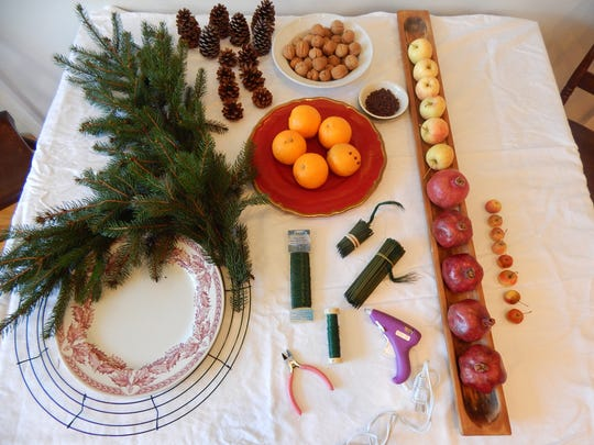 Supplies used to make the table wreath include a wire
