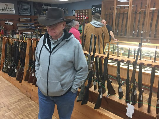 Retired computer programmer and firearms enthusiast Cephas Wright peruses the wares at The Outdoorsman gun shop in Santa Fe, N.M., on Thursday, Jan. 5, 2017. Currents in the national debate over gun regulations are converging on New Mexico as the state Legislature prepares to meet. Wright criticized a new proposal to allow the concealed carry of handguns without a special license, and also said it was unrealistic to administer background checks on all firearms sales at gun shows.