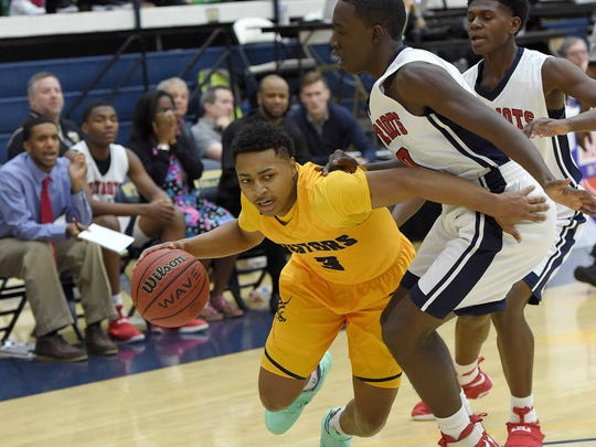 Olive Branch's Joe Cooper (3) tries to get by Forest Hill's Quaylon Lee (0) on Monday, January 16, 2017, in the Rumble in the South high school basketball tournament at the A.E. Wood Coliseum on the Mississippi College campus in Clinton, Miss.