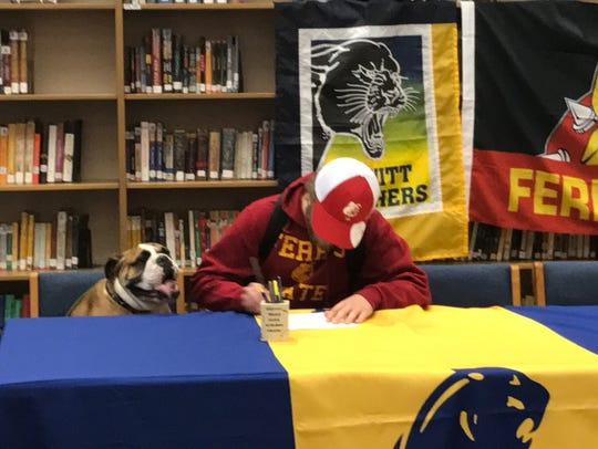 Flanked by a bulldog, DeWitt's JD Ross signs with Ferris