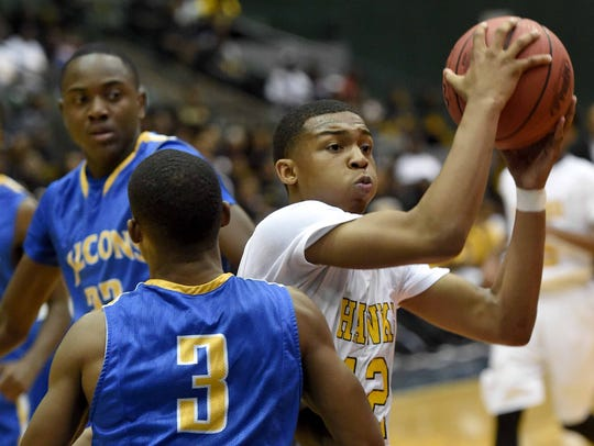 Holly Springs' Daquan Smith (12) drives past Velma