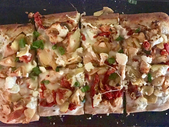 The Mediterranean flatbread ($12) is topped with artichokes, red peppers, sun dried tomatoes, Kalamata olives and roasted garlic.
