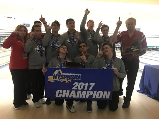 North Rockland's boys bowling points up after winning the state championship in memory of friend and competitor Brandon Smith, who passed away earlier in the week. The team kept Smith's bowling towel (pictured center) during the tournament.