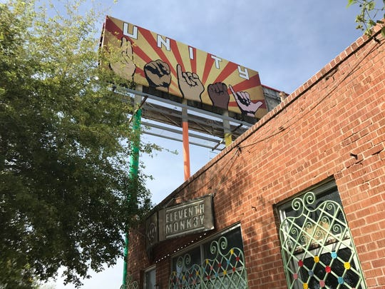 A billboard sign depicting President Donald Trump's