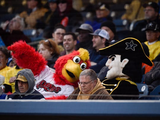 The Sounds and Vanderbilt mascots watch the game during