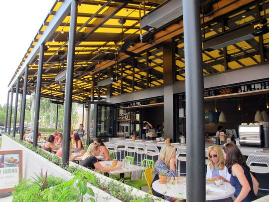 The patio and indoor-outdoor bar at True Food Kitchen, which recently opened at Waterside Shops in Naples.