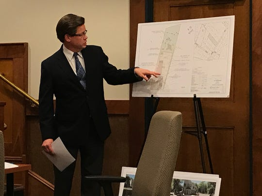 Engineer Michael Petry reviews Tree Tavern's site plans