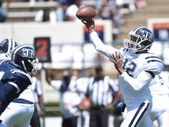 Brent Lyles (12) passes over the Blue team's defensive line on Saturday, April 8, 2017, in the Jackson State University Blue and White Spring Game at Mississippi Veterans Memorial Stadium in Jackson, Miss.