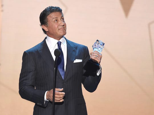 Sylvester Stallone accepts the Best Supporting Actor