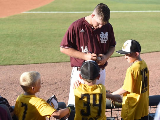 MIssissippi State's Riley Self (14) signs autographs