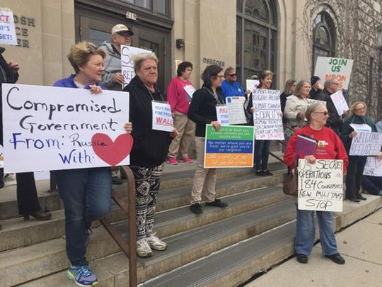 Resisters gather for a weekly protest outside GOP Sen. Ron Johnson's office in Oshkosh, Wis. (Lisa Mascaro/Los Angeles Times/TNS)