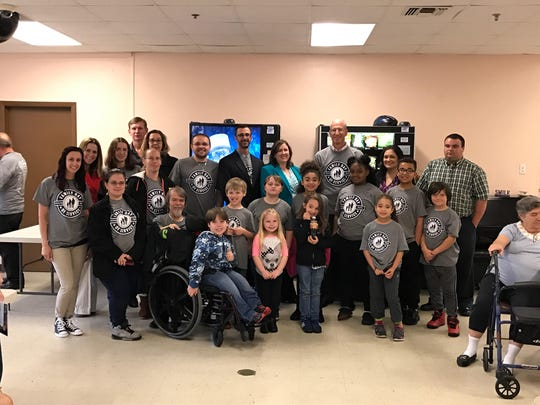 The Giving Sunshine Project team from Silver Run Elementary School in Millville pose during visit to Riverview West high-rise.