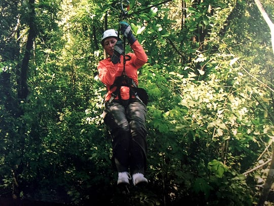 Ilene Michalski of Macomb Township zip lines on one