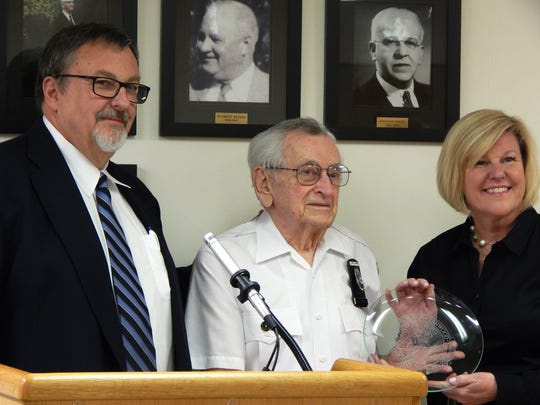Fanwood Councilman Tom Kranz, a 19-year member, joined Mayor Colleen Mahr in making the presentation of a crystal plate with the town's seal engraved.
