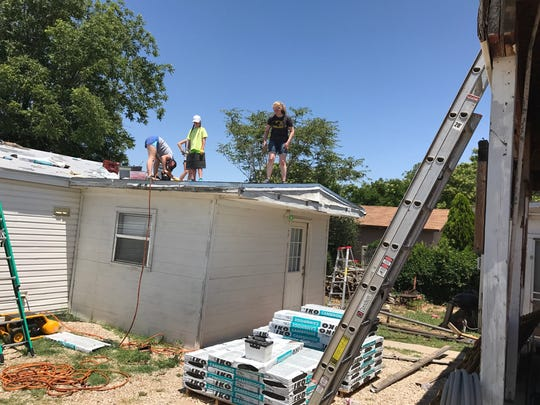 Mission Carlsbad started working on Maurice Smith's home Monday. They are repairing his roof, porch and repainting his picket fence.