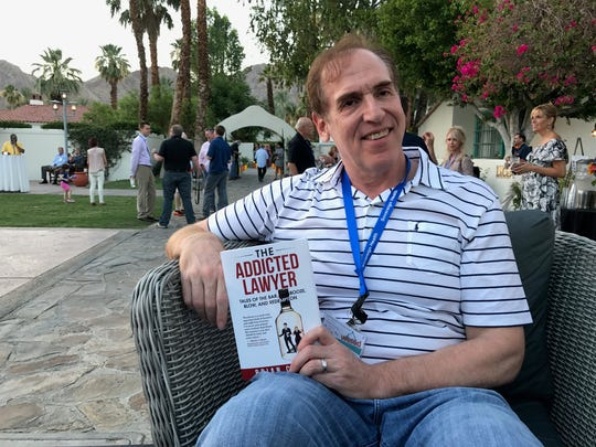 Brian Cuban proudly displays his latest book which