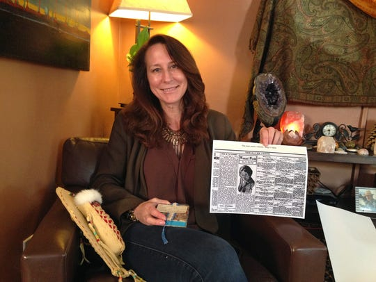Betsy Roddy of Los Angeles holds a copy of the Aug.