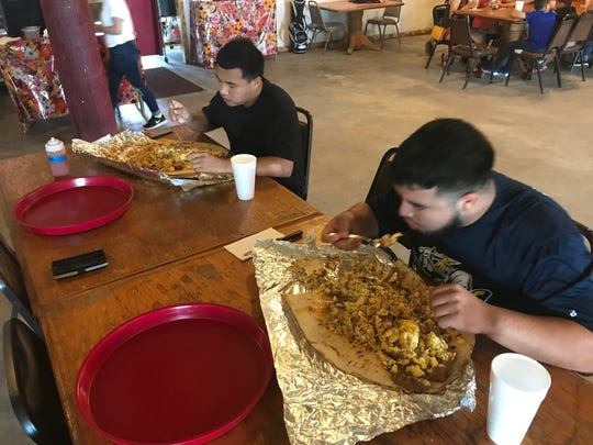 Christopher Villarreal(left) and Cristian Lopez(right) trying to take on the Recio's Breakfast Taco Challenge