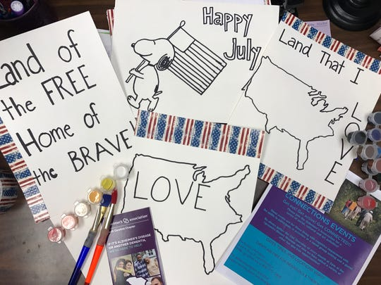 Connections members made patriotic signs for the Fourth of July.