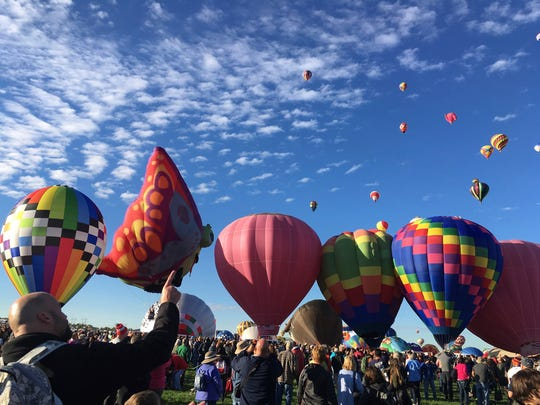 "In this Oct. 1, 2016 photo, visitors at the Albuquerque International Balloon Fiesta in Albuquerque, N.M. watch as balloons launch. New Mexico Gov. Susana Martinez unveiled ""record-breaking"" state tourism figures at the Albuquerque International Balloon Museum on Wednesday, July 5, 2017."