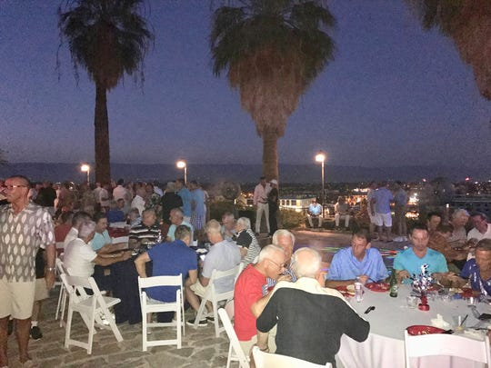 Guests feast on a traditional Fourth of July barbecue dinner.