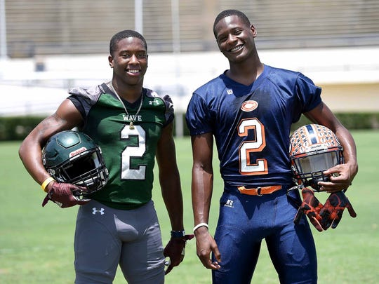 Two receivers, both wearing No. 2, (from left) West Point's Marcus Murphy and Callaway's Malik Heath, pose for pictures at the Dandy Dozen photo shoot at Mississippi Veterans Memorial Stadium in Jackson on July 26, 2017.