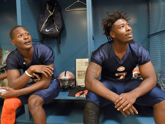 Callaway's James Williams (right) and Malik Heath relax in the locker room at the Dandy Dozen photo day at Mississippi Veterans Memorial Stadium in Jackson on July 26, 2017.