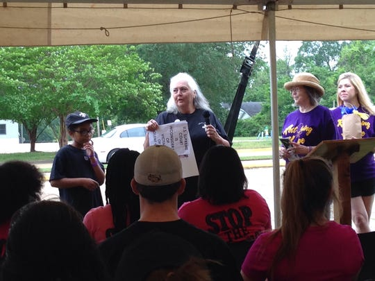 Sharon Yarbrough (center) speaks to the crowd about her late aunt's case at a past Victims Rights Parade. Rita Rabalais was 82 when she was murdered in her Alexandria home as part of a gang initiation.