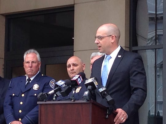 Chief deputy prosecutor Dave Sunday (right) announces that York City Police and the York County Drug Task Force have reconciled after a more than four-year split. York City Police Chief Wes Kahley (middle) and York County Sheriff Rich Keuerleber (left) look on. (Liz Evans Scolforo photo)