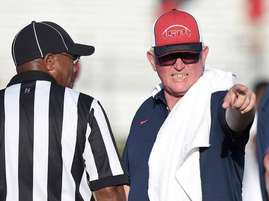 South Panola head coach Ricky Woods (right) has words with an official on Thursday, August 17, 2017, at Clinton High School in Clinton, Miss.